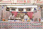 Amsterdam Poffertjes, small dutch pancakes, are served on the Albert Cuyp Market in Amsterdam.