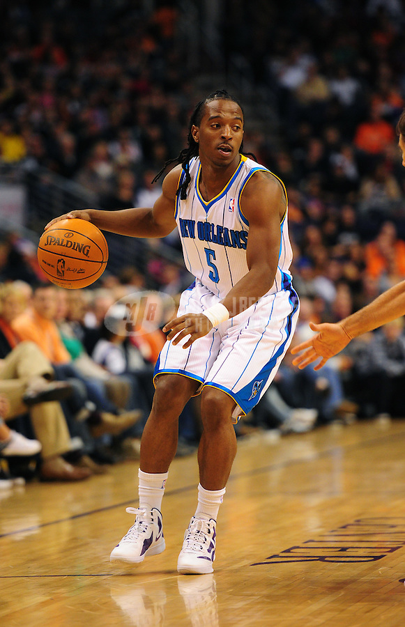 Dec. 26, 2011; Phoenix, AZ, USA; New Orleans Hornets guard Cardell Johnson controls the ball during game against the Phoenix Suns at the US Airways Center. The Hornets defeated the Suns 85-84. Mandatory Credit: Mark J. Rebilas-USA TODAY Sports