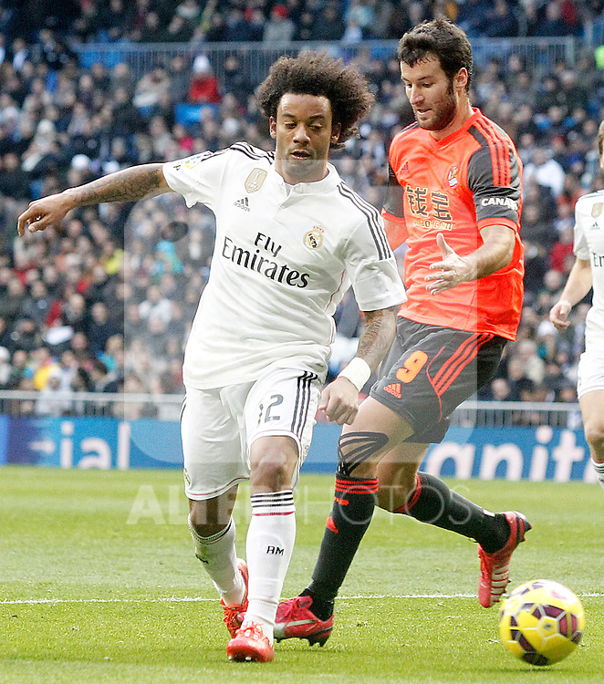 Real Madrid's Marcelo Vieira (l) and Real Sociedad's Imanol Agirretxe during La Liga match.January 31,2015. (ALTERPHOTOS/Acero)