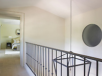 The master bedroom is glimpsed through an open door from the landing