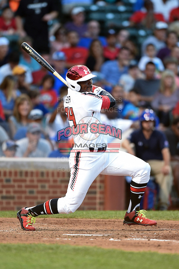 Starling Heredia (24) of Santo Domingo, Dominican Republic representing the Dominican Prospect League during the Under Armour All-American Game on August 16, 2014 at Wrigley Field in Chicago, Illinois.  (Mike Janes/Four Seam Images)