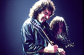 Black Sabbath - Tony Iommi and Ozzy Osbourne - performing live at the first reunion concert of the original line-up at the NEC Arena in Birmingham UK - 04 Dec 1997.  Photo credit: George Chin/IconicPix