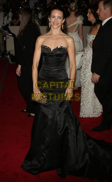"KRISTIN DAVIS.The Metropolitan Museum of Art's Costume Institute Gala ""American Woman: Fashioning A National Identity"" held at the Metropolitan Museum of Art, New York, NY, USA..May 3rd, 2010.full length black strapless dress gown maxi clutch bag .CAP/LNC/TOM.©TOM/LNC/Capital Pictures."