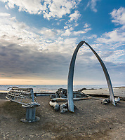 Jawbones from the Bowhead whale and umiaks (walrus boat frame) along the Arctic Ocean in Utqiagvik (Barrow) Alaska in Alaska's Arctic.