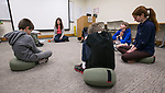 Dr. Martha Mason rings a singing bowl after leading students in a breathing meditation during a class Thursday, April 27, 2017, to introduce children to mindfulness practices such as breathing and observation. (PHOTO RELEASES ON ALL CHILDREN WERE SECURED) (DePaul University/Jamie Moncrief)