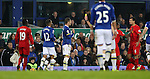 Ross Barkley of Everton is booked for a tackle on Jordan Henderson of Liverpool are spoken to by referee Mike Dean during the English Premier League match at Goodison Park, Liverpool. Picture date: December 19th, 2016. Photo credit should read: Lynne Cameron/Sportimage