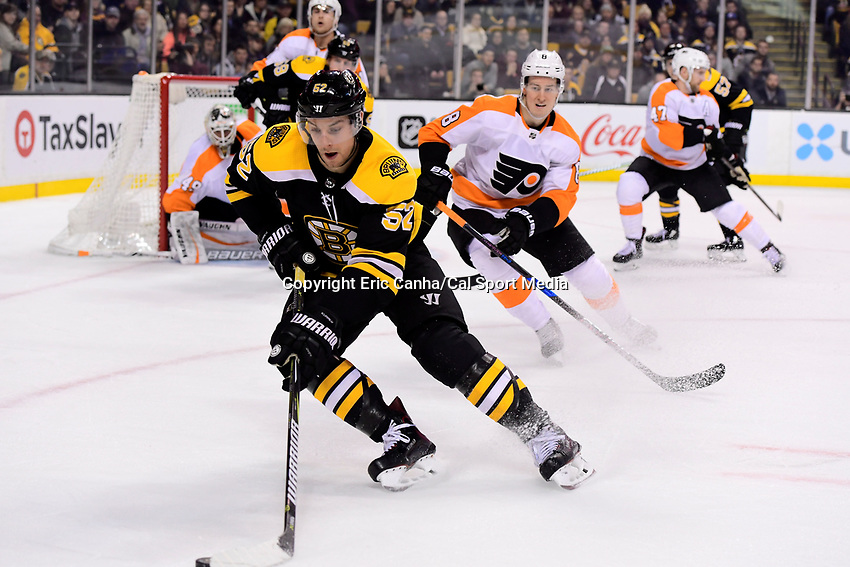 March 8, 2018: Boston Bruins center Sean Kuraly (52) gathers the puck during the NHL game between the Philadelphia Flyers and the Boston Bruins held at TD Garden, in Boston, Mass. Boston defeats Philadelphia 3-2 in regulation time. Eric Canha/CSM