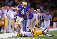 Sept. 5, 2009; Seattle, WA, USA; Washington Huskies wide receiver (9) Devin Aguilar runs from LSU Tigers cornerback (4) Jai Eugene at Husky Stadium. LSU defeated Washington 31-23. Mandatory Credit: Mark J. Rebilas-
