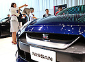 July 27, 2016, Yokohama, Japan - Japanese automobile giant Nissan Motor employee displays the company's flagship sports car GT-R at the company's showroom in Yokohama, suburban Tokyo on Wednesday, July 27, 2016. Nissan announced the company's operating profit for the first quarter fell 9.2 percent to 175.8 billion yen since string yen and trouble of the MMC's mini car Days and Days Roox.    (Photo by Yoshio Tsunoda/AFLO) LWX -ytd-