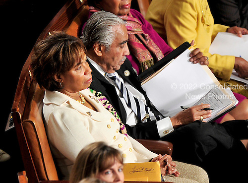 United States Representative Charlie Rangel (Democrat of New York), right, reads through a notebook as he waits to be sworn-in for another term in the U.S. House of Representatives. U.S. Representative Barbara Lee (Democrat of California), is seated at left. .Credit: Ron Sachs / CNP.(RESTRICTION: NO New York or New Jersey Newspapers or newspapers within a 75 mile radius of New York City)