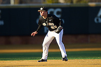 Wake Forest Demon Deacons shortstop Jimmy Redovian (23) on defense against the Georgetown Hoyas at Wake Forest Baseball Park on February 16, 2014 in Winston-Salem, North Carolina.  The Demon Deacons defeated the Hoyas 3-2.  (Brian Westerholt/Four Seam Images)