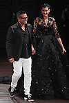 Fashion designer Naeeh Khan walks runway with model at the close of his Naeem Khan Bridal Spring 2017 collection runway fashion show, at 260 West 36 Street, during New York Bridal Fashion Week Spring Summer 2017 on April 16, 2016.