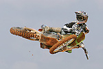 """AMA Supercross star James """"Bubba"""" Stewart flies high over a private supercross track on his family's 100-acre farm in Haines City, Fla., during a practice session, Wednesday, April 19, 2006.(AP Photo/Brian Myrick)"""