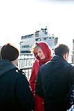 USA, New York, woman tourist waiting to take a boat from the Statue of Liberty to Ellis Island