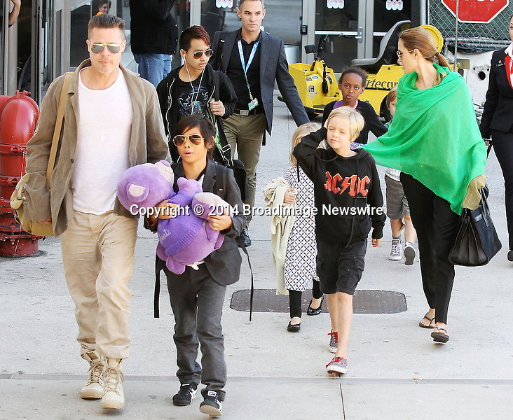 Pictured: Brad Pitt, Angelina Jolie, Shiloh Nouvel Jolie-Pitt, Maddox Chivan Jolie-Pitt, Pax Thien Jolie-Pitt, Knox Leon Jolie-Pitt, Zahara Marley Jolie-Pitt, Vivienne Marcheline Jolie-Pitt<br /> Mandatory Credit &copy; Ben Foster/Broadimage<br /> Brad Pitt, Angelina Jolie and family arriving at the Los Angeles International Airport<br /> <br /> 2/5/14, Los Angeles, California, United States of America<br /> <br /> Broadimage Newswire<br /> Los Angeles 1+  (310) 301-1027<br /> New York      1+  (646) 827-9134<br /> sales@broadimage.com<br /> http://www.broadimage.com<br /> <br /> <br /> Pictured: Brad Pitt, Angelina Jolie, Shiloh Nouvel Jolie-Pitt, Maddox Chivan Jolie-Pitt, Pax Thien Jolie-Pitt, Knox Leon Jolie-Pitt, Zahara Marley Jolie-Pitt, Vivienne Marcheline Jolie-Pitt<br /> Mandatory Credit &copy; Ben Foster/Broadimage<br /> Brad Pitt, Angelina Jolie and family arriving at the Los Angeles International Airport<br /> <br /> 2/5/14, Los Angeles, California, United States of America<br /> Reference: 020514_HDLA_BDG_030<br /> <br /> Broadimage Newswire<br /> Los Angeles 1+  (310) 301-1027<br /> New York      1+  (646) 827-9134<br /> sales@broadimage.com<br /> http://www.broadimage.com