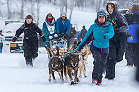 Handlers walk Charmayne Morrison's team to the startline of the 2018 Junior Iditarod Sled Dog Race on Knik Lake in Southcentral, Alaska.  Saturday February 24, 2018<br /> <br /> Photo by Jeff Schultz/SchultzPhoto.com  (C) 2018  ALL RIGHTS RESERVED