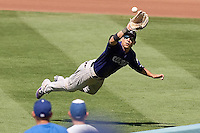 08/28/11 Los Angeles, CA: Colorado Rockies right fielder Carlos Gonzalez #5 makes a diving catch during a MLB game played at Dodger Stadium between the Los Angeles Dodgers and the Colorado Rockies.  The Rockies defeated the Dodgers 7-6