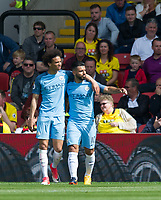 Leroy Sane puts an arm around goalscorer Sergio Aguero of Manchester City during the Premier League match between Watford and Manchester City at Vicarage Road, Watford, England on 21 May 2017. Photo by Andrew Aleksiejczuk.