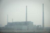 Daytime landscape view from the Tianjin Binhai Light Rail of smokestacks at an industrial site near the Binhai New Area Tanggu District in Tiānjīn.  © LAN