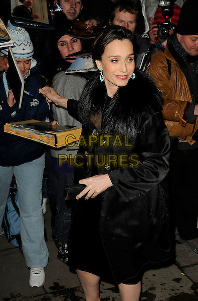 KRISTIN SCOTT THOMAS.London Film Critics' Circle Awards, Grosvenor House Hotel, London, England, .February 4th 2009 .full length black fur collar coat 3/4 fans signing autographs .CAP/CAN.©Can Nguyen/Capital Pictures.