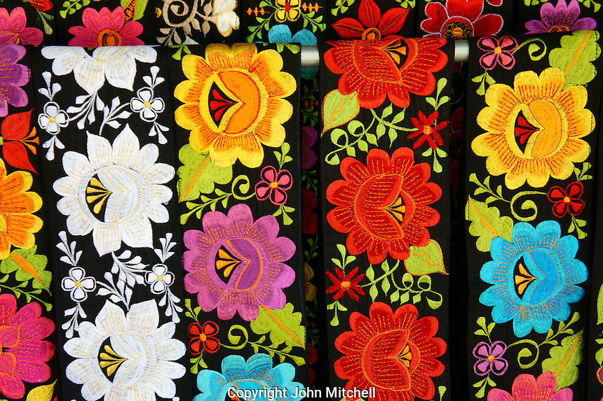 Coolrful floral sashes  for sale at the Sunday handicrafts market in Merida, Yucatan, Mexico...