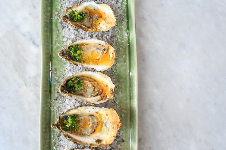 Raleigh, North Carolina - Saturday September 26, 2015 - Roasted oysters, preserved lemon, chili butter.
