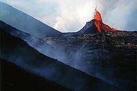 Bright colored eruption of a vent in a rocky landscape