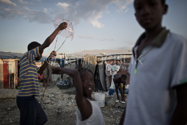 © Remi OCHLIK/IP3 - Port au Prince on 2010 december 2  Tensions simmered in Haiti with its political future hanging in the balance, as protesters renewed charges of vote-rigging and cholera fears led to deadly mob violence.As vote-counting continued ahead of the expected release of preliminary results on Tuesday, candidates in last weekend's presidential and legislative elections remained split over whether to endorse the outcome. Daily life in refugges aviation camp