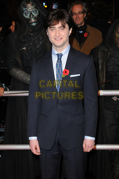 "DANIEL RADCLIFFE .""Harry Potter And The Deathly Hallows: Part 1"" World Film Premiere, Empire cinema Leicester Square and Odeon Leicester Square, London, England, UK, 11th November 2010. .half length black blue navy suit tie poppy shirt  .CAP/CAS.©Bob Cass/Capital Pictures."
