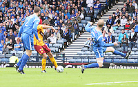 Keith Lasley shooting as Steven Anderson sticks out a leg to try and stop the shot