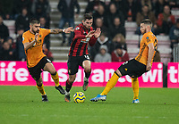 Bournemouth's Lewis Cook (centre) is under pressure from Wolverhampton Wanderers' Ruben Neves (left) & Matt Doherty (right) <br /> <br /> Photographer David Horton/CameraSport<br /> <br /> The Premier League - Bournemouth v Wolverhampton Wanderers - Saturday 23rd November 2019 - Vitality Stadium - Bournemouth<br /> <br /> World Copyright © 2019 CameraSport. All rights reserved. 43 Linden Ave. Countesthorpe. Leicester. England. LE8 5PG - Tel: +44 (0) 116 277 4147 - admin@camerasport.com - www.camerasport.com