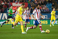 Atletico de Madrid´s Arda Turan and Villarreal´s Denis Cheryshev during 2014-15 La Liga match between Atletico de Madrid and Villarreal at Vicente Calderon stadium in Madrid, Spain. December 14, 2014. (ALTERPHOTOS/Luis Fernandez) /NortePhoto