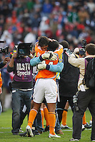 Houston Dynamo midfielder (14) Dwayne De Rosario and goalkeeper (18) Pat Onstad are surrounded by TV cameras as they celebrate winning the MLS Cup. The Houston Dynamo defeated the New England Revolution 2-1 in the finals of the MLS Cup at RFK Memorial Stadium in Washington, D. C., on November 18, 2007.