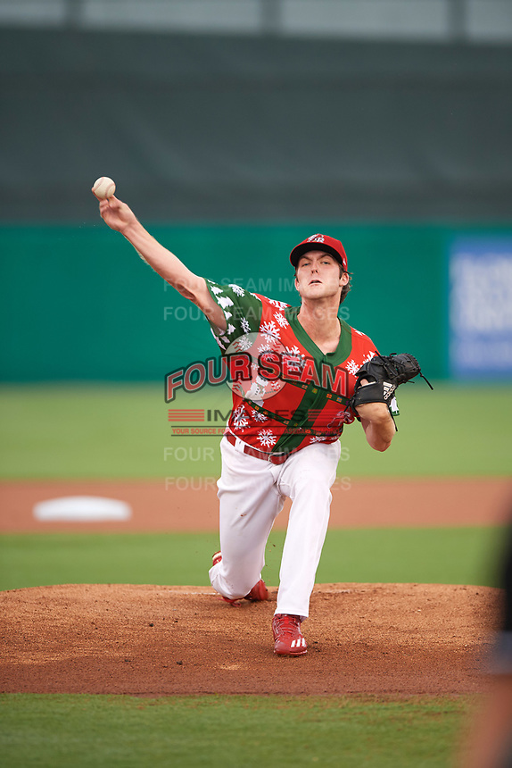 """Palm Beach Cardinals starting pitcher Jake Woodford (33) delivers a warmup pitch during a game against the Charlotte Stone Crabs on July 22, 2017 at Roger Dean Stadium in Palm Beach, Florida.  The Cardinals wore special """"Ugly Sweater"""" jerseys for Christmas in July.  Charlotte defeated Palm Beach 5-2.  (Mike Janes/Four Seam Images)"""