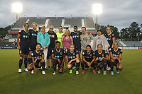 Cary, North Carolina  - Wednesday May 24, 2017: North Carolina Courage starters and fans. Players: front row (from left): Yuri Kawamura, Taylor Smith, McCall Zerboni, Debinha, Jaelene Hinkle, Lynn Williams; back row (from left): Abby Erceg, Samantha Mewis, two fans, Katelyn Rowland, fan, Jessica McDonald, two fans, and Abby Dahlkemper prior to a regular season National Women's Soccer League (NWSL) match between the North Carolina Courage and the Sky Blue FC at Sahlen's Stadium at WakeMed Soccer Park. The Courage won the game 2-0.