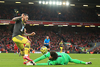 1st February 2020; Anfield, Liverpool, Merseyside, England; English Premier League Football, Liverpool versus Southampton; Liverpool goalkeeper Alisson rushes of his line to smother a shot from Danny Ings of Southampton