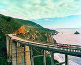 USA, California, Big Sur, a couple on a road trip drives South on HWY 1 across the Bixby Bridge