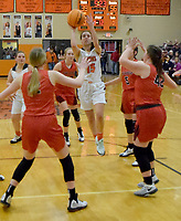 Westside Eagle Observer/MIKE ECKELS<br /> <br /> Surrounded by a flock of Lady Blackhawks, Shylee Morrison (Lions 15) puts up a jumper from the top of the key during the final game of the 2019-20 season between Gravette and Pea Ridge Friday night in the competition gym.