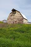 Yellow wooden weathered barn in Washington's Palouse.
