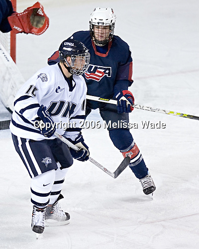 Kevin Shattenkirk keeps an eye on Peter LeBlanc in front of the US net. The University of New Hampshire Wildcats defeated the United States National Team Development Program's Under-18 Team 7-1 on Saturday, October 14, 2006 at the Whittemore Center in Durham, New Hampshire.<br />