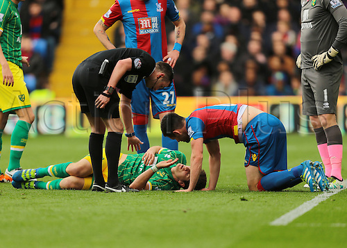 09.04.2016. Selhurst Park, London, England. Barclays Premier League. Crystal Palace versus Norwich. Referee Michael Oliver checks on Norwich City Defender Timm Klose injury after colliding with Crystal Palace Defender Scott Dann  during a Crystal Palace corner