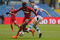 (L-R) Tammy Abraham of Swansea City challenged by Morgan Fox of Sheffield Wednesday during The Emirates FA Cup Fifth Round match between Sheffield Wednesday and Swansea City at Hillsborough, Sheffield, England, UK. Saturday 17 February 2018