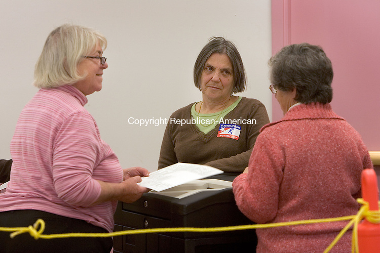 BARKHAMSTED, CT. 08 November 2010-110810SV04--From left, Cynthia Williams, head moderator, feeds ballots into the voting machine with the help of Karen Brett and Carroll Hughes during a the 63rd House District recount in Barkhamsted Monday.<br /> Steven Valenti Republican-American