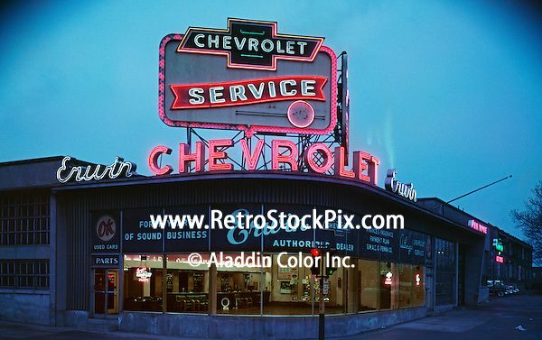 Erwin Chevrolet Car Dealership at night. Huge neon sign. 1958. PA.