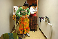 """Members of the Roma or gypsy theater Romathan change into their costumes to perform for young children in """"Dwarf"""" at the Banske Elementary School with a Roma or gypsy majority student body in Banske, Slovakia on June 2, 2010."""