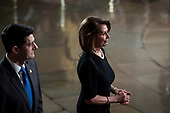 WASHINGTON, DC - DECEMBER 3 : Outgoing Speaker Paul D. Ryan and  Nancy Pelosi walk away after paying their respects to former president George H.W. Bush as he lies in State at the U.S. Capitol Rotunda on Capitol Hill on Monday, Dec. 03, 2018 in Washington, DC. (Photo by Jabin Botsford/Pool)