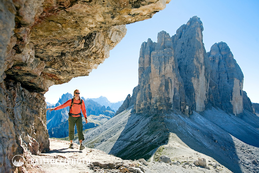 Amy Rasic hiking along a Via Ferrata with the Tre Cime di Lavaredo in the background