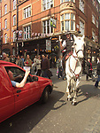 A51PBF Policeman on white horse talking with angry man in red van Covent Garden London England