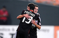 D.C. United defender Daniel Woolard (21) celebrates with teammate Chris Pontius (13) his score. D.C. United defeated The Vancouver Whitecaps FC 4-0 at RFK Stadium, Saturday August 13 , 2011.
