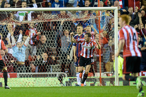 06.05.2013 Sunderland, England. Sunderland's John O'Shea celebrates after scoring against Stoke and levelling the score sheet for ten-man Sunderland (1-1) during the Premier League game between Sunderland and Stoke from Stadium of Light.